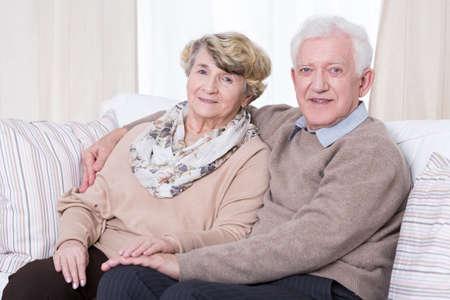 Portrait of happy senior couple at home Stockfoto