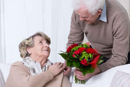 getting together: Happy senior couple having golden wedding anniversary