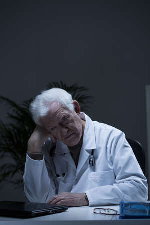 practiced: Image of experienced doctor suffering for depression Stock Photo