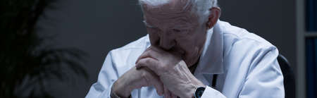 registrar: Depressed troubled doctor in his office - panorama Stock Photo