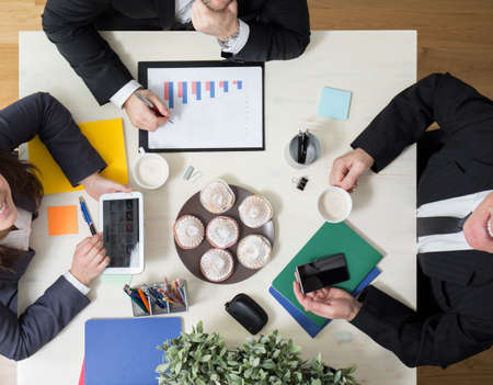 polls: Sweet snack on business meeting Stock Photo