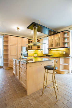Big vinatge style kitchen with marble floor photo