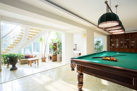 Big pool table in spacious living room Stock Photo