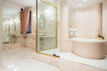 Two big mirrors in enormous luxury bathroom photo