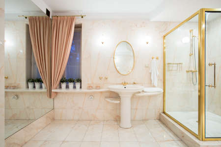 Fancy shower with glass door and golden frame photo