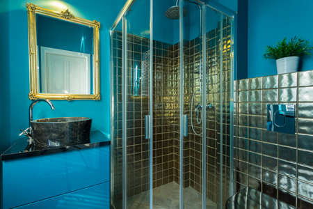 gleaming: Interior of exclusive bathroom with blue walls