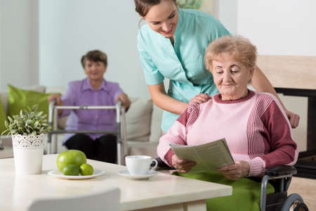 age care: Old women and a nurse taking care of them