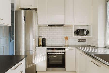 new home: New chrome fridge in luxury white kitchen