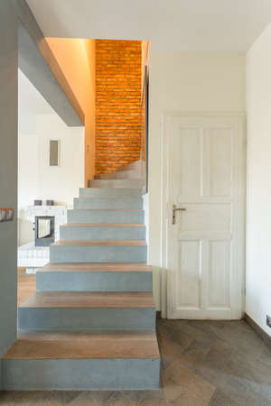 a detached living room: Close-up of stairway in contemporary detached house