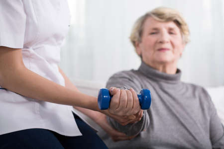 resistance: Senior woman during resistance training with dumbbell Stock Photo