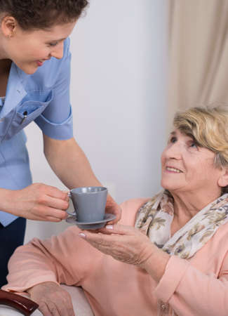 home care nurse: Image of senior care assistant at work Stock Photo