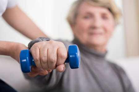 elderly: Close-up of elder woman training with physiotherapist Stock Photo