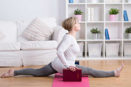 splits: Image of sporty mature woman doing the splits Stock Photo