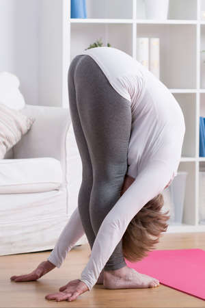 bending down: Picture of stretched mature lady bending down