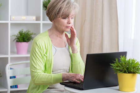 Middle aged woman having problems with computer