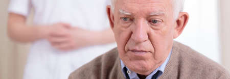 despairing: Portrait of sad retiree having depression - panorama Stock Photo