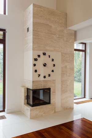 stone  fireplace: Big stone modern fireplace in new empty living room