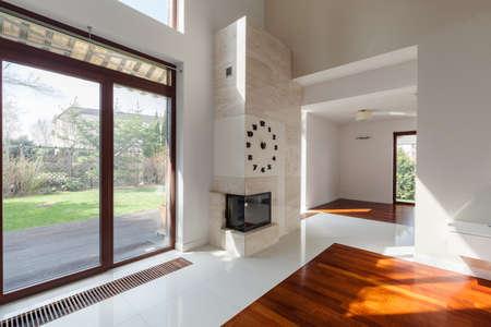 Modern living room with big window overlooking the garden