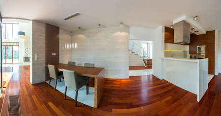 Panoramic photo of modern kitchen and dining hall