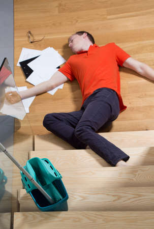 untidiness: Young unconscious man having a dangerous accident