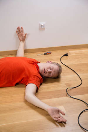 Young unconscious man having serious accident with electricity photo