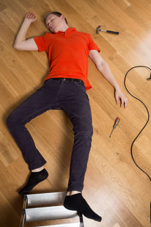 inattentive: Young man on the floor having dangerous accident at home Stock Photo