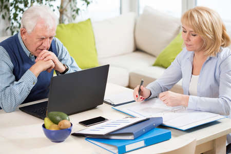 transact: Mature couple working together at home Stock Photo