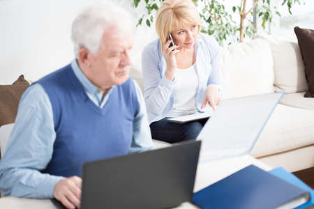 transact: Senior businesspeople working together at home