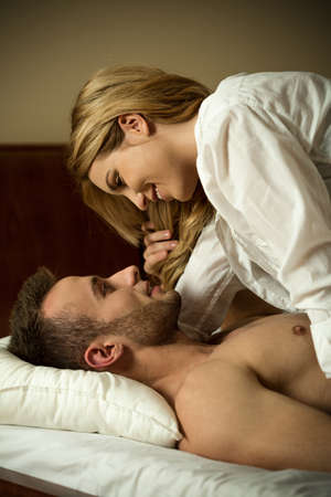 Picture of young affectionate couple in bed Stock Photo