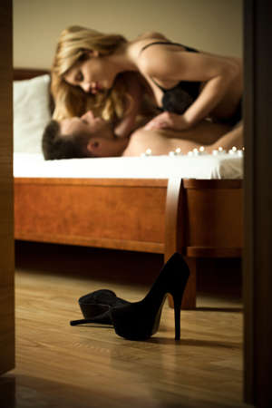 sexual nude: Vertical view of passionate couple in bedroom