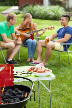 garden barbecue: Happy student spending nice time on barbeque party