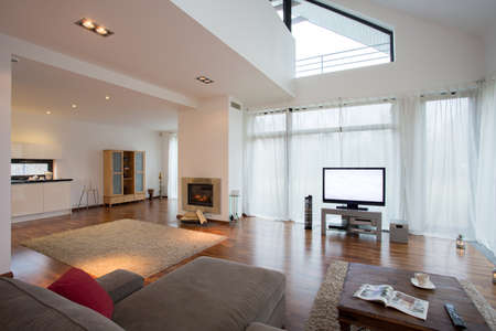 home cinema: Spacious modern lounge with wooden floor Stock Photo