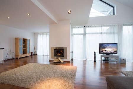 home cinema: Big bright living room with soft beige carpet
