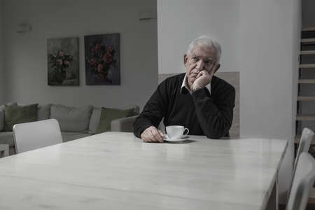 one senior: Senior sad lonely man and his coffee time Stock Photo