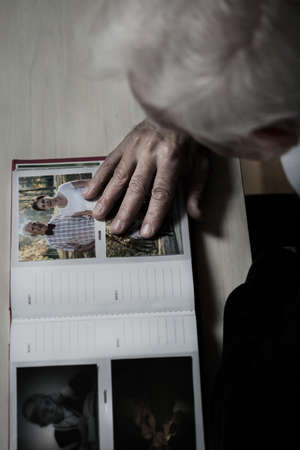 Older depressed man remembering his wife photo