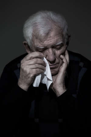 lonely man: Photo of older, depressed lonely man crying