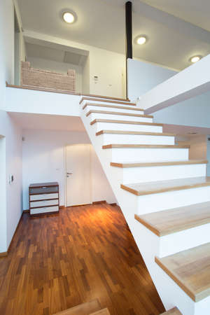 wooden stairs: Fancy wooden stairs without rails in big residence