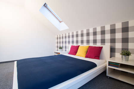king size: King size bed with colorful sheet in new bedroom