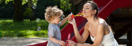 Mom and little boy making soap bubbles