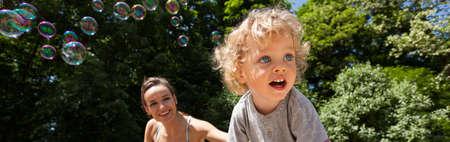 family fun: Horizontal view of holidays on the playground