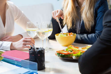snack time: Young businesspeople during their break in office Stock Photo