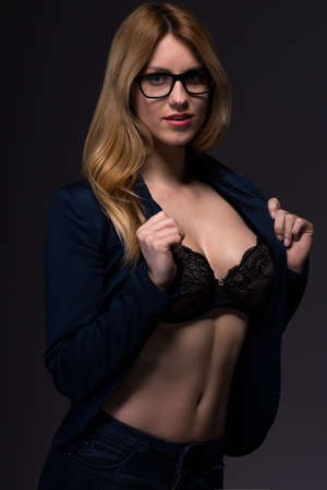naked girl body: Provocative beauty businesswoman showing her sexy bra Stock Photo