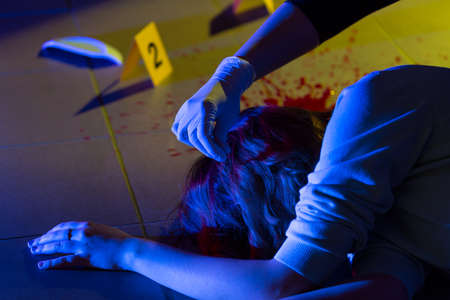 murder scene: Victim of crime and forensic science technician