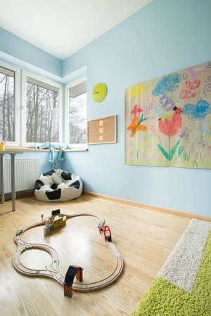 kids bedroom: Train set on the floor in childs room
