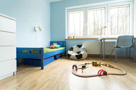 kid room: Horizontal view of cute blue kids room