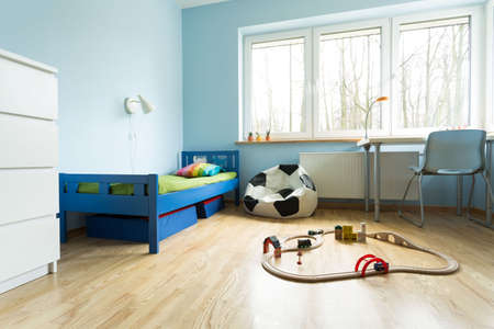 Horizontal view of cute blue kids room