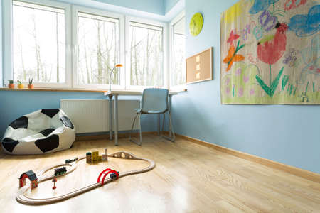 drawing room: Ball shape sofa and train set in child room