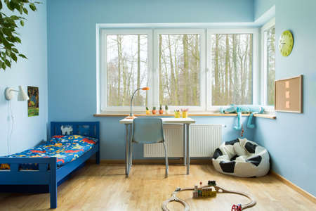 boy room: Ball shape sofa in boy toddler room Stock Photo
