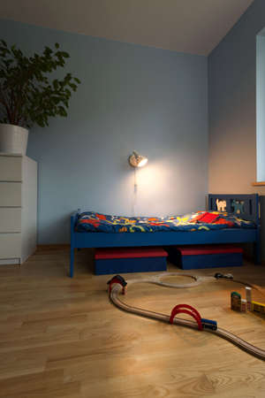 bedcover: Vertical view of beauty bedroom for boy Stock Photo