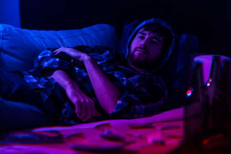 addicted: Addicted man being on drugs lying on the sofa Stock Photo